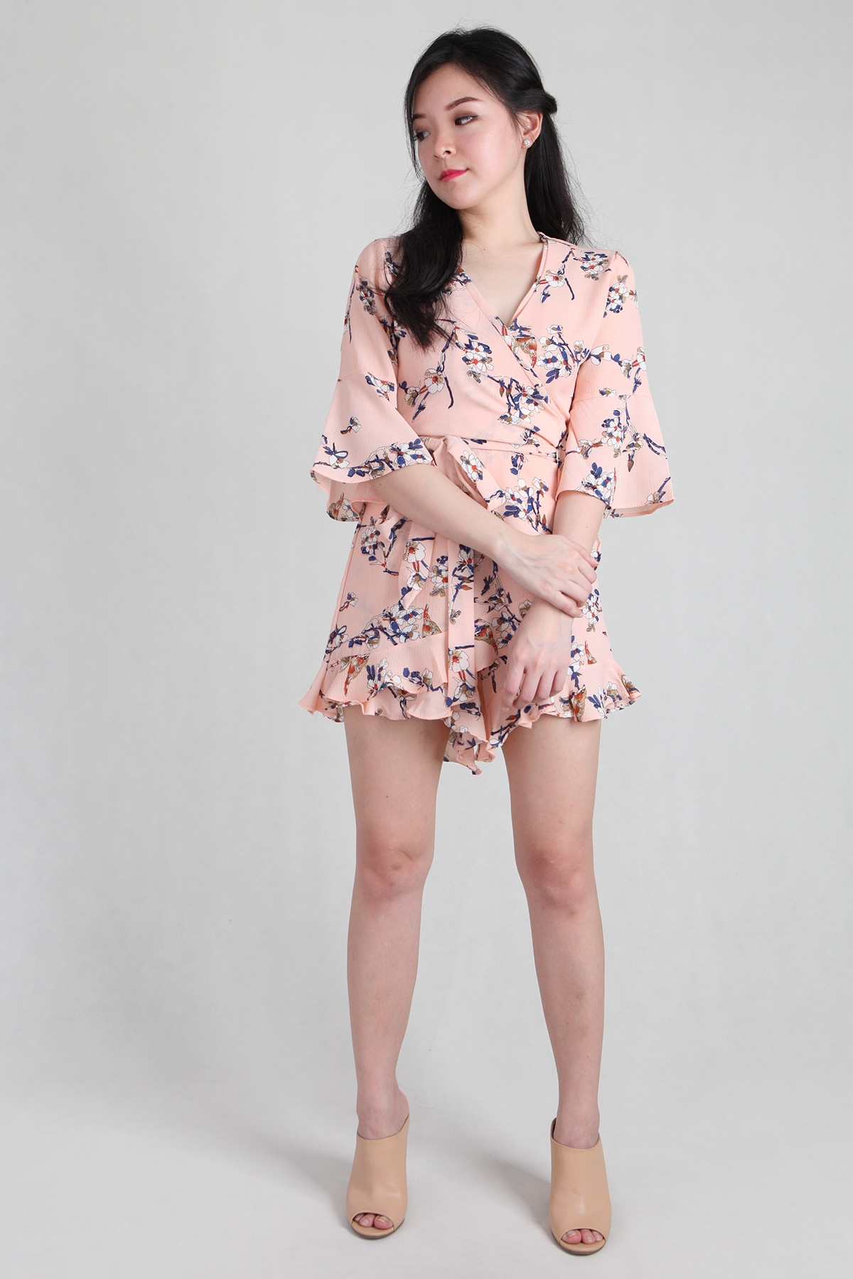 Floral Ruffles Playsuit in Peach